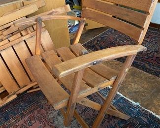 One of chairs with shorter arms