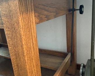 Crank on side to adjust angle of drafting table