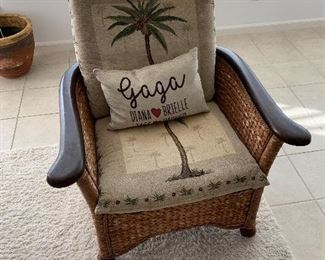 Wicker chair with palm tree cushions