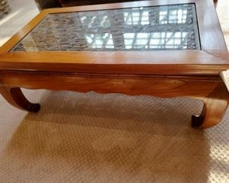 Carved wood under glass coffee table