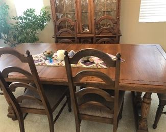 Beautiful kitchen table with six chairs. Has option of making shorter or longer, depending on your needs.