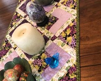 Table top knickknacks (candle, decorated eggs, bird)