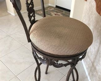 Front of elegant wrought iron and wood bar stool