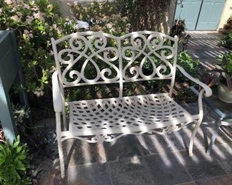 Outside wrought iron patio bench
