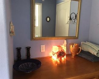 Wall mirror, bowl, light up glass cube, pitcher, and candle holders