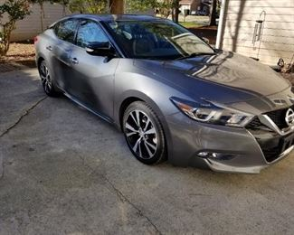 This is a 2018 Maxima SV with 59,000 miles. The ask is $22,35