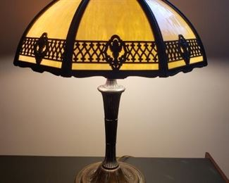 """Vintage slag glass table lamp made by Bradley and Hubbard has a very heavy base. Lamp measures 16.5"""" at it's widest point and is approximately 24"""" tall. Very good condition. Base says patent applied for and light sockets are labeled Bryant. Lamp base and shade are marked Bradley and Hubbard.  https://ctbids.com/#!/description/share/756676"""