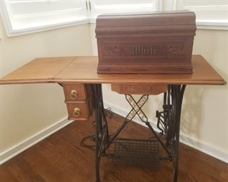 This beautiful antique White treadle sewing machine with cabinet and wooden cover dates back to 1893 based on serial number of 662341. Includes instructions in German and a box of accessories by Johnstons. This one sold for $1299 in 2020: https://www.worthpoint.com/worthopedia/antique-1885-white-treadle-sewing-2107571736  https://ctbids.com/#!/description/share/756694