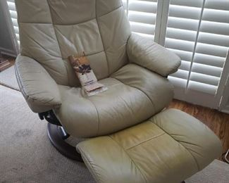 """$800 value. Sit back and relieve your stress with this Stressless recliner by Ekornes.  """"In 1971 Ekornes launched the first Stressless recliner. It soon became known for its innovative functions, unmatched comfort and Scandinavian look."""" Ottoman has discoloration, see pictures.  https://ctbids.com/#!/description/share/756696"""