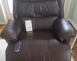 Purchased new about one year ago for $2099. See video! Be the envy of your next get together and show off your new La-Z-Boy dark brown leather power recliner. Remote has options for head rest, foot rest and even lumbar support.   https://ctbids.com/#!/description/share/756695