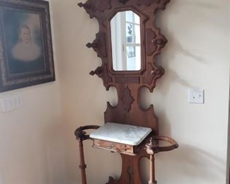 Beautiful antique hall tree with marble top and small drawer. Very, very fragile.  https://ctbids.com/#!/description/share/756713