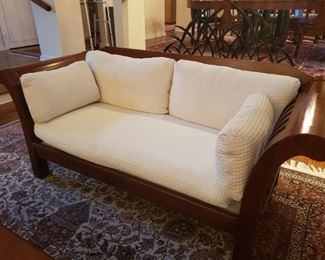"""2 of 2 Hickory Chair Co. Wood Sleigh Sofa #2 This gorgeous sleigh style sofa by Hickory Chair Furniture Co. will be a statement piece in your house.  It measures 72"""" long, 32"""" in high and 20"""" depth. Cushions and pillows are ivory and very luxurious. Hickory Chair Co. makes some of the finest and well designed furniture pieces in the United States http://www.hickorychair.com/. Please see the matching sofa in another lot.  https://ctbids.com/#!/description/share/756837"""