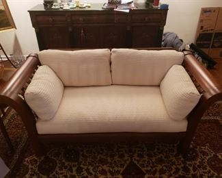 """1 of 2 Hickory Chair Co. Wood Sleigh Sofa #1 This gorgeous sleigh style sofa by Hickory Chair Furniture Co. will be a statement piece in your house.  It measures 72"""" long, 32"""" in high and 20"""" depth. Cushions and pillows are ivory and very luxurious. Hickory Chair Co. makes some of the finest and well designed furniture pieces in the United States http://www.hickorychair.com/. Please see the matching sofa in another lot.  https://ctbids.com/#!/description/share/756838"""