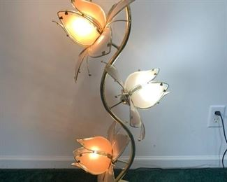 This brass lamp features glass accents to form the flower decorations of each fixture. The fixtures are in working condition and have been tested. The power cable is in good condition and has no signs of wear. 17x40  https://ctbids.com/#!/description/share/755983