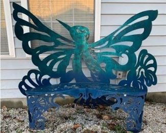 This wrought iron bench features a hummingbird design built into the back with flourishes cut into the metal forming an artistic design all the way down from the seat to the feet. 50x19x40 Seat height: 16  https://ctbids.com/#!/description/share/755999