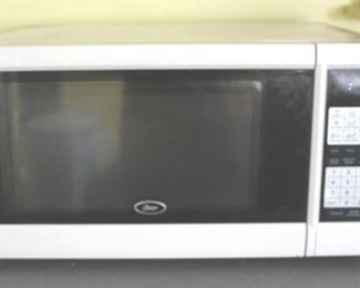 136 - Oster Microwave