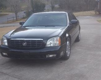 Beautiful Black 2005 Cadillac Deville DTS.  Has approx 121K miles.  Six photos of exterior ....