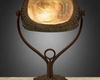 "3 A Tiffany Studios ""Turtle-Back"" Seal Lamp 1903; New York, NY Signed: [T.G.D.Co. monogram] / Tiffany Studios / New York / 29743 The ""Turtle-Back"" shade with gold iridescent glass with shades of green and hobnail design on a verdigris patinated bronze base with iridescent cabochons and floral motif, electrified 14.5"" H x 8.5"" W x 5.25"" D Estimate: $5,000 - $7,000"