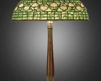 """25 A Tiffany Studios """"Acorn"""" Table Lamp Circa 1902-1919; New York, NY Shade signed: Tiffany Studios / New York; Base signed: Tiffany Studios / New York / 534 The green and cream leaded glass """"Acorn"""" shade on a three-light patinated bronze """"Colonial"""" base with a hexagonal column, electrified Overall: 21.5"""" H x 16"""" Dia. Estimate: $6,000 - $8,000"""