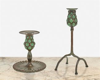 """34 Two Tiffany Studios Bronze And Blown Glass Candlesticks Circa 1902-1919; New York, NY First signed: Tiffany Studios; Second signed: Tiffany Studios / New York / 294 Each candlestick patinated bronze, comprising one with four-legged """"inverted cradle"""" base and green blown glass capital with removable bobeche and one with fluted oval base and green blown glass capital with wide bobeche, 2 pieces Larger: 11"""" H x 4.5"""" W x 4.5"""" D; Smaller: 6.75"""" H x 6.25"""" Dia. Estimate: $2,000 - $3,000"""