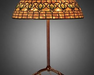 """62 A Tiffany Studios """"Pomegranate"""" Table Lamp Circa 1902-1919; New York, NY Shade signed: Tiffany Studios / New York / 1457; Base signed: Tiffany Studios / New York The yellow and green leaded glass """"Pomegranate"""" shade on a three-light patinated bronze four-legged """"inverted cradle"""" base, electrified Overall: 23.5"""" H x 16"""" Dia. Estimate: $6,000 - $8,000"""