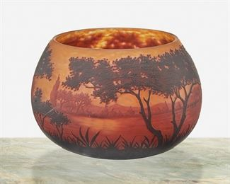 """82 A Daum Cameo Glass """"Paysage Du Lac"""" Bowl First-quarter 20th Century; Nancy, France Signed: Daum Nancy [Croix de Lorraine] The acid-etched cameo glass bowl cut from dark red and red to orange frost with wooded lakeside motif 5.5"""" H x 8"""" Dia. Estimate: $1,000 - $1,500"""