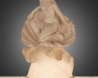 """89 A Carved Alabaster Birth Of Venus Table Lamp First-quarter 20th Century Signed indistinctly to base The carved alabaster table lamp depicting the goddess Venus emerging from a shell atop crashing waves, electrified 21"""" H x 11"""" W x 9.5"""" D Estimate: $700 - $900"""