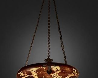 """94 A Daum Cameo Glass """"Grape And Vine"""" Pendant Chandelier First-quarter 20th Century; Nancy, France Signed: Daum Nancy [Croix de Lorraine] The acid-etched cameo glass domical shade with grape and vine motifs cut from purple to light green and orange frost fitted with one light socket and wrought iron hardware and canopy, electrified 30"""" H x 16"""" Dia. Estimate: $2,000 - $3,000"""