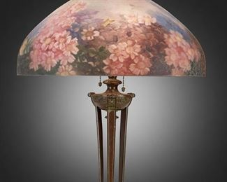"""105 A Handel Reverse-Painted Glass """"Rose Blossom"""" Table Lamp Circa 1919; Meriden, Connecticut Shade signed: Handel Lamps / Pat'd. No. 979664 / Handel / 6688; Base signed: Handel [cloth label] The domical chipped ice finished glass shade with reverse-painted polychrome rose blossom and butterfly motifs on a three-light bronzed metal tripod base with scrolled anthemion supports and foliate motifs set on a circular foot with gadrooned border, electrified Overall: 24.5"""" H x 18"""" Dia. Estimate: $2,000 - $3,000"""