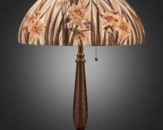 """106 A Handel Reverse-Painted Glass """"Daffodil"""" Table Lamp First-quarter 20th Century; Meriden, Connecticut Shade signed: Handel Lamps / Pat'd. No. 979664 / Handel / 7042 / R.G.; Base signed: Handel The domical chipped ice finished glass shade with reverse-painted red daffodils and blades of grass against a light blue ground on a two-light patinated metal base with tapered column, circular foot, and chipped ice texture throughout, electrified Overall: 22"""" H x 15"""" Dia. Estimate: $2,000 - $3,000"""
