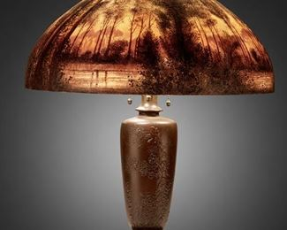"""108 A Handel Painted Glass Landscape Table Lamp Circa 1914; Meriden, Connecticut Shade signed: Handel / Pat'd. No. 979664 / Handel / 6209 / J.P. [Joseph Palme]; Base signed: Handel The domical, chipped ice and sand-finished glass shade with obverse and reverse-painted wooded lakeside landscape at sunset in tones of brown, green, and orange on a three-light patinated metal base in the form of a Japanese vase molded with low relief birds and prunus blossoms raised on a stepped Chinese pierced hardwood-style foot, electrified Overall: 22"""" H x 18"""" Dia. Estimate: $2,000 - $3,000"""