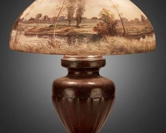 """109 A Handel Reverse-Painted Glass Landscape Table Lamp Circa 1918; Meriden, Connecticut Shade signed: Handel Lamps / Pat'd. No. 979664 / Handel / 6638; Base signed: Handel The domical, chipped ice finished glass shade with reverse-painted birch woodland scene in green and grey against a purple and blue twilight sky with rising moon on a three-light patinated metal base with an urn-form body raised on a square foot, electrified Overall: 23"""" H x 18"""" Dia. Estimate: $1,500 - $2,000"""