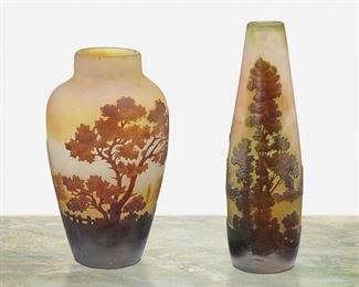 """112 Two Gallé Cameo Glass Landscape Vases Late 19th/early 20th Century; Nancy, France Each signed: Galle Each acid-etched cameo glass cut from dark amber to yellow frost with tree motifs, comprising one tapered bud vase and one wide-shouldered vase, 2 pieces Larger: 7"""" H x 2.25"""" Dia. Estimate: $800 - $1,200"""