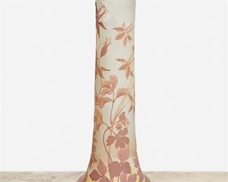 """114 A Tall Gallé Cameo Glass """"Columbine"""" Vase Late 19th/early 20th Century; Nancy, France Signed: Galle The acid-etched cameo glass cylindrical """"Columbine"""" vase with wide base and flared rim cut from mauve and pink to clear and yellow frost 24"""" H x 9"""" Dia. Estimate: $1,000 - $1,500"""
