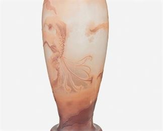 """117 A Tall Gallé Cameo Glass """"Lily"""" Vase Late 19th/early 20th Century; Nancy, France Signed: Galle The acid-etched cameo glass """"Lily"""" footed vase with wide base, scalloped rim, and tapered body cut from mauve to peach frost 19.75"""" H x 6.5"""" Dia. Estimate: $1,000 - $1,500"""