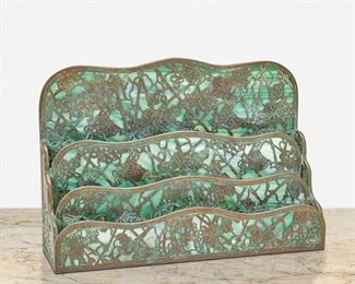 """135 A Tiffany Studios """"Grape Vine"""" Letter Rack Circa 1902-1919; New York, NY Signed: Tiffany Studios / New York / 1007 The patinated bronze letter rack with verdigris patination, green mottled glass, and """"Grape Vine"""" motif overlay fitted with three compartments 8.75"""" H x 12.75"""" W x 3.5"""" D Estimate: $800 - $1,200"""