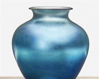 "147 A Blue Steuben Aurene Glass Vase Circa 1905-1933; Corning, New York Signed: Steuben / Aurene / 2683 The blue Aurene glass vase, model no. 2683, with wide-shouldered body and flared neck 10.75"" H x 10"" Dia. Estimate: $500 - $700"