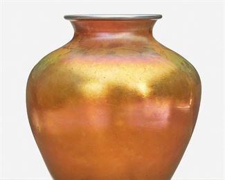 """148 A Gold Steuben Aurene Glass Vase Circa 1904-1933; Corning, New York Signed: Steuben / Aurene / 2683 The gold Aurene glass vase, model no. 2683, shaded pink with wide-shouldered body and flared neck 10.75"""" H x 9.5"""" Dia. Estimate: $600 - $800"""