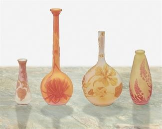 """159 Four Gallé And Muller Frères Cameo Glass Bud Vases Late 19th/early 20th Century; France Two signed: Galle; One signed: Galle [starred]; One signed: Muller Each acid-etched cameo glass, comprising one tall-necked """"Chrysanthemum"""" vase with flared rim cut from orange to orange frost, one tall-necked """"Nasturtium"""" vase cut from yellow to white frost, one tapered """"Delphinium"""" vase cut from red to chartreuse frost, and one flared vase with floral motif cut from chartreuse and red to white frost, 4 pieces Largest: 8"""" H x 2.625"""" W x 1.625"""" D; Smallest: 3.75"""" H x 1.375"""" Dia. Estimate: $800 - $1,200"""