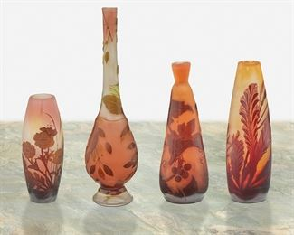 """158 Four Gallé Cameo Glass Bud Vases Late 19th/early 20th Century; Nancy, France Each signed: Galle Each acid-etched cameo glass, comprising one tapered tall-neck vase cut from amber to pink frost with foliate motif, one flared """"Grapes and Vines"""" vase cut from red to orange frost, one tapered """"Marine"""" vase cut from red to yellow frost, and one tapered """"Poppy"""" vase cut from amber to pink frost, 4 pieces Largest: 9.625"""" H x 2.58"""" Dia.; Smallest: 5.125"""" H x 2"""" Dia. Estimate: $800 - $1,200"""