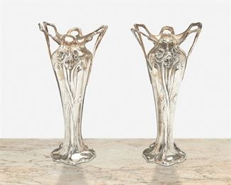 """172 A Pair Of Jugendstil-Style English Pewter Vases 20th Century Each marked: JJP-RMP; First further marked: 7; Second further marked: 84 By A.E. Williams, each vase with double handles and figural motif depicting a stylized female figure with flowers in her hair, 2 pieces Each: 8.5"""" H x 4"""" Dia. Estimate: $600 - $800"""