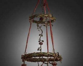 """181 A Two-Tier Painted Metal Chandelier First-quarter 20th Century The two-tiered, four-light painted metal chandelier with two wreath-style circular frames decorated with red berries and gilt bows surrounding a central descending rose vine tendril, fitted with four rose-style drop pendant lights terminating in pink oil speckled Bohemian glass shades with spun green overlay, electrified 56"""" H x 26"""" Dia. Estimate: $1,500 - $2,000"""