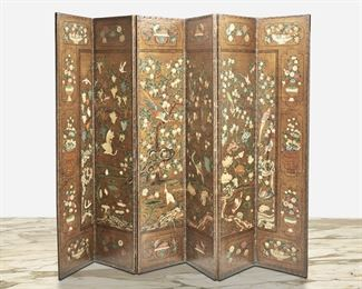 """183 A Continental Hand-Painted Leather Folding Screen Circa 1920s Possibly Italian, the six-paneled room divider in hand-painted leather with Chinoiserie decoration depicting exotic birds, flowers, and grape vines surrounded by floral cartouches and finished with a nail stud trim Each panel: 102"""" H x 22"""" W x 1.125"""" D; Overall: 102"""" H x 132"""" W x 1.125"""" D Estimate: $1,000 - $1,500"""