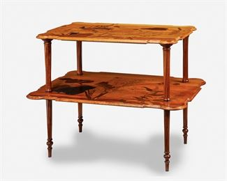 """184 A Gallé Two-Tiered Marquetry Table Circa 1885-1904; Nancy, France Inscribed signature: Emile Galle / Nancy / EG / [Croix de Lorraine] The rectangular two-tiered table with shaped top supported by four spiraling ribbed columns over a widening undershelf, each with marquetry flowers, foliage, and butterflies, raised overall on four spiraling ribbed legs with tapering turned feet, the upper tier with fitted glass top 31"""" H x 37.25"""" W x 26"""" D Estimate: $2,500 - $3,500"""