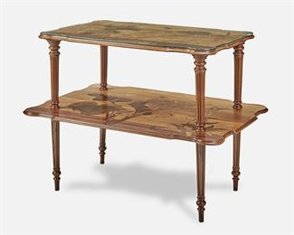 """185 A Gallé Two-Tiered Marquetry Table Circa 1885-1904; Nancy, France Inscribed signature: Emile Galle / Nancy / EG / [Croix de Lorraine] The rectangular two-tiered table with shaped top supported by four fluted columns over a widening undershelf, each with marquetry flowers, foliage, and butterflies, raised overall on four fluted legs with tapering turned feet, the upper tier with fitted glass top 30.5"""" H x 37.25"""" W x 25.75"""" D Estimate: $2,500 - $3,500"""