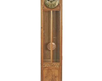 """189 A Jugendstil Walnut Longcase Clock Late 19th/early 20th Century; Germany Movement signed: Mullko 21 / Harmonie Vollgong / P 100 1955331 With a silvered dial with black Arabic numerals through twelve, red Arabic numerals through twenty-four, black minute track, three weights, and pendulum in a carved walnut case with vine and berry motif and a glazed beveled glass door raised on bracket feet 91"""" H x 18.25"""" W x 11"""" D Estimate: $1,000 - $1,500"""
