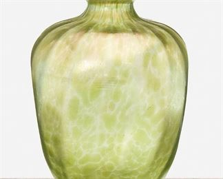 """204 A Loetz Crete Papillon Vase Late 19th/early 20th Century Signed: Loetz / Austria The four-sided vase with flared rim and descending ribbed details in iridescent green Crete Papillon glass 8.75"""" H x 6"""" Dia. Estimate: $300 - $500"""