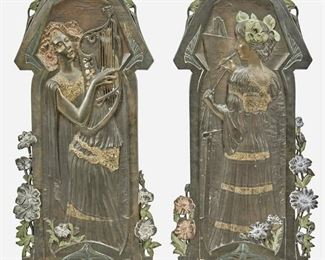 """205 Two Jugendstil Cast Metal Figural Plaques Late 19th/early 20th Century; Germany Each marked: ME [obelisk] / Musterschutz; Further marked: 7196 / 7197 Possibly designed by Wilhelm Elster Jr. (1869-1916, German), each cast metal figural plaque with cold painted highlights and depicting the arts of music and painting, 2 pieces Each: 28.25"""" H x 12"""" W x .25"""" D Estimate: $800 - $1,200"""