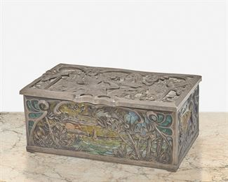 """208 An Art Nouveau Pewter And Glass Vanity Box Late 19th/early 20th Century The rectangular, hinged lid pewter box with polychrome glass mosaic panels depicting seaside and wooded landscapes and a figural scene with a gilt interior 2.5"""" H x 6"""" W x 3.5"""" D Estimate: $800 - $1,200"""