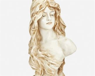 """215 An Amphora """"Reflexion"""" Ceramic Bust Late 19th/early 20th Century Marked: Amphora / 1243 / 21 The ceramic bust depicting a woman with flowing hair atop a squared plinth inscribed """"Reflexion"""" 20"""" H x 10.5"""" W x 8"""" D Estimate: $500 - $700"""